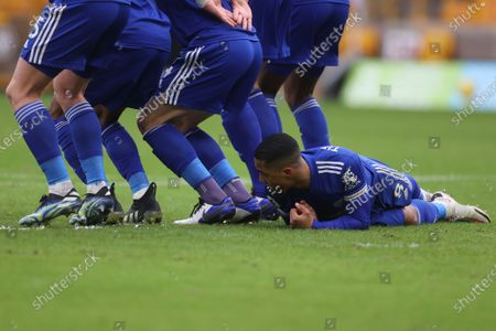 Leicester's Youri Tielemans lays on the ground during the English Premier League match between Wolves and Leicester City at the Molineux Stadium in Wolverhampton, England