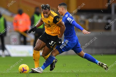 Wolverhampton Wanderers' Adama Traore, left, is challenged by Leicester's Youri Tielemans during the English Premier League match between Wolves and Leicester City at the Molineux Stadium in Wolverhampton, England