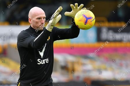 Wolverhampton Wanderers' goalkeeper John Ruddy warms up ahead of the English Premier League match between Wolves and Leicester City at the Molineux Stadium in Wolverhampton, England