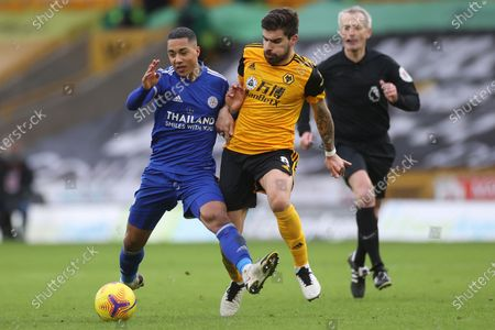 Leicester's Youri Tielemans, left, is challenged by Wolverhampton Wanderers' Ruben Neves during the English Premier League match between Wolves and Leicester City at the Molineux Stadium in Wolverhampton, England