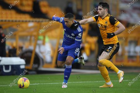 Leicester's Youri Tielemans, left, is challenged by Wolverhampton Wanderers' Pedro Neto during the English Premier League match between Wolves and Leicester City at the Molineux Stadium in Wolverhampton, England