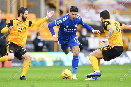 Leicester's Ayoze Perez, center, is challenged by Wolverhampton Wanderers' Ruben Neves, right and Wolverhampton Wanderers' Joao Moutinho during the English Premier League match between Wolves and Leicester City at the Molineux Stadium in Wolverhampton, England