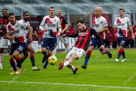 Milan's Davide Calabria, foreground, tries to score during the Serie A soccer match between AC Milan and Crotone at the San Siro stadium in Milan, Italy