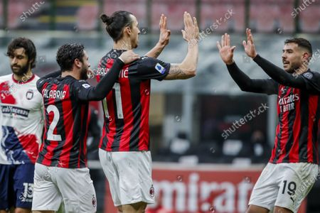 Milan's Zlatan Ibrahimovic, center, is congratulated by teammate Davide Calabria, left, and Theo Hernandez after scoring his second goal during the Serie A soccer match between AC Milan and Crotone at the San Siro stadium in Milan, Italy