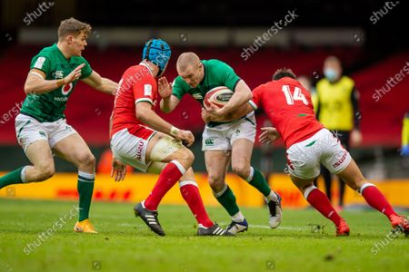 Keith Earls of Ireland is tackled by Louis Rees-Zammit of Wales