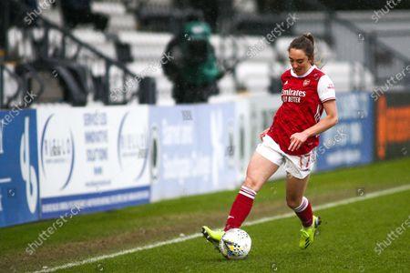 Lisa Evans (#17 Arsenal) controls the ball (action)