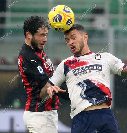 AC Milan's Davide Calabria (L) and Crotone's Pedro Pereira vie for the ball during the Italian serie A soccer match between AC Milan and FC Crotone at Giuseppe Meazza stadium in Milan, Italy, 07 February  2021.