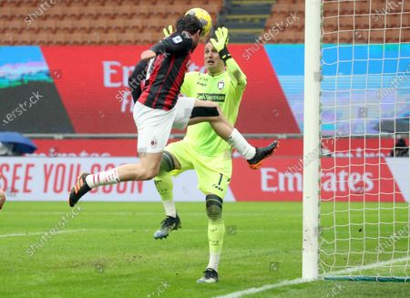 AC Milan's Davide Calabria and Crotone's goalkeeper Alex Cordaz (R) vie for the ball during the Italian serie A soccer match between AC Milan and FC Crotone at Giuseppe Meazza stadium in Milan, Italy, 07 February  2021.