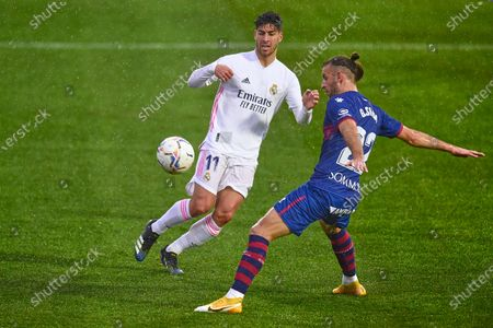Marco Asensio of Real Madrid and Gaston Silva of SD Huesca