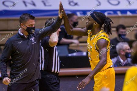 Valparaiso's Sheldon Edwards high fives head coach Matt Lottich during an NCAA college basketball game against Drake, in Valparaiso, Ind. Drake won 80-77