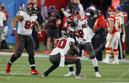 Tampa Bay Buccaneers (L-R) Ndamukong Suh, Jason Pierre-Paul and Shawuil Barrett celebrate a stop against the Kansas City Chiefs in the second quarter of the National Football League Super Bowl LV at Raymond James Stadium in Tampa, Florida, USA, 07 February 2021.