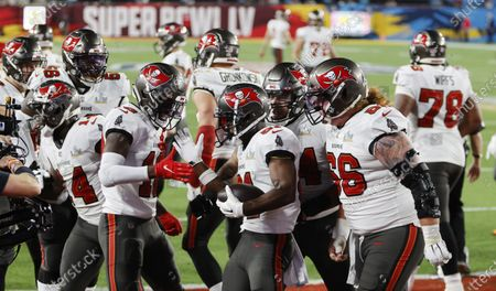 Tampa Bay Buccaneers wide receiver Antonio Brown (C) celebrates with teammates after catching a touchdown pass against the Kansas City Chiefs in the second quarter of the National Football League Super Bowl LV at Raymond James Stadium in Tampa, Florida, USA, 07 February 2021.