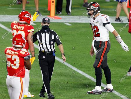 Tampa Bay Buccaneers quarterback Tom Brady (R) and Kansas City Chiefs strong safety Tyrann Mathieu (L) exchange world after a play during the first half of the National Football League Super Bowl LV at Raymond James Stadium in Tampa, Florida, USA, 07 February 2021.