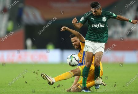 Rony of Brazil's Palmeiras, front, and Javier Aquino of Tigres UANL fight for the ball during FIFA Club World Cup semi final in Al Rayyan, Qatar