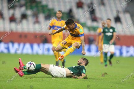 Matias Vina of Brazil's Palmeiras tackles Javier Aquino of Tigres UANLl during FIFA Club World Cup semi final in Al Rayyan, Qatar