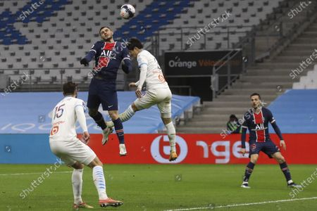 PSG's Mauro Icardi, top left, jumps for the ball with Marseille's Hiroki Sakai during the French League One soccer match between Olympique de Marseille and Paris Saint-Germain at the Velodrome stadium in Marseille, southern France