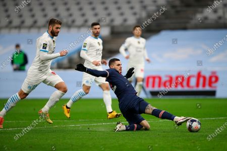 PSG's Mauro Icardi, right, attempts a shot at goal in front of Marseille's Duje Caleta-Car during the French League One soccer match between Olympique de Marseille and Paris Saint-Germain at the Velodrome stadium in Marseille, southern France