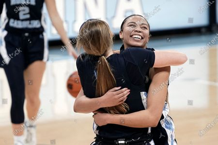 North Carolina guard Stephanie Watts, right, hugs guard Alyssa Ustby following an NCAA college basketball game against North Carolina State in Chapel Hill, N.C