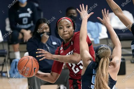 Stock Photo of North Carolina State forward Kayla Jones (25) passes around North Carolina guard Stephanie Watts (5) during the first half of an NCAA college basketball game in Chapel Hill, N.C