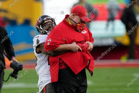 Tampa Bay Buccaneers running back LeSean McCoy picks up Kansas City Chiefs' Andy Reid before the NFL Super Bowl 55 football game between the Kansas City Chiefs and Tampa Bay Buccaneers, in Tampa, Fla