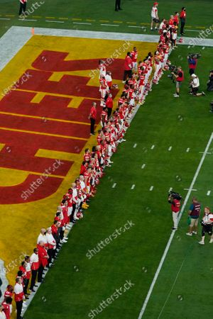 """The Kansas City Chiefs listen as Alicia Keys performs """"Lift Every Voice and Sing"""" virtually before the NFL Super Bowl 55 football game between the Kansas City Chiefs and Tampa Bay Buccaneers, in Tampa, Fla"""