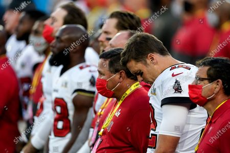 """Tampa Bay Buccaneers quarterback Tom Brady listens as Alicia Keys performs """"Lift Every Voice and Sing,"""" before the NFL Super Bowl 55 football game between the Kansas City Chiefs and Tampa Bay Buccaneers, in Tampa, Fla"""