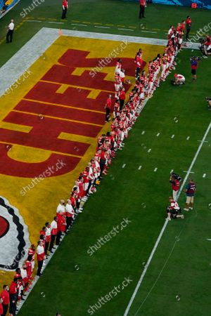 """Stock Photo of The Kansas City Chiefs listen as Alicia Keys performs """"Lift Every Voice and Sing"""" virtually before the NFL Super Bowl 55 football game between the Kansas City Chiefs and Tampa Bay Buccaneers, in Tampa, Fla"""
