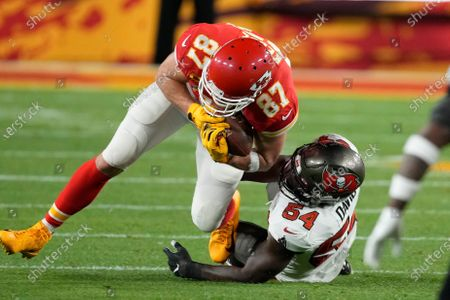 Kansas City Chiefs tight end Travis Kelce (87) is tackled by Tampa Bay Buccaneers inside linebacker Lavonte David (54) after catching a pass during the first half of the NFL Super Bowl 55 football game, in Tampa, Fla