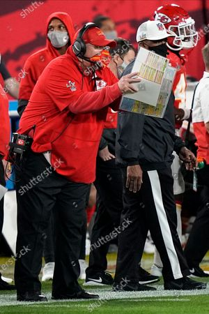 Kansas City Chiefs' Andy Reid works during the first half of the NFL Super Bowl 55 football game against the Tampa Bay Buccaneers, in Tampa, Fla