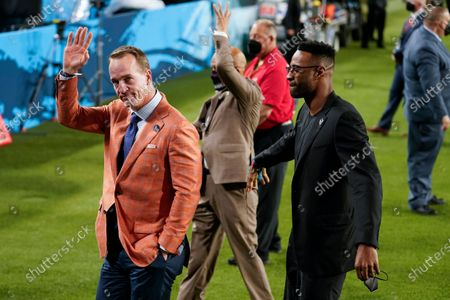 Stock Image of Former quarterback Peyton Manning, left, motions to the crowd during the first half of the NFL Super Bowl 55 football game between the Kansas City Chiefs and the Tampa Bay Buccaneers, in Tampa, Fla