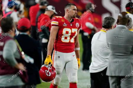 Kansas City Chiefs tight end Travis Kelce stands on the sidelines during the first half of the NFL Super Bowl 55 football game against the Tampa Bay Buccaneers, in Tampa, Fla