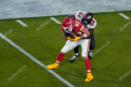 Kansas City Chiefs' Travis Kelce (87) is tackled by Tampa Bay Buccaneers' Lavonte David (54) during the first half of the NFL Super Bowl 55 football game, in Tampa, Fla