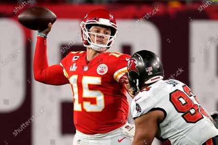 Kansas City Chiefs quarterback Patrick Mahomes (15) throws a pass under pressure by Tampa Bay Buccaneers defensive end Ndamukong Suh, right, during the second half of the NFL Super Bowl 55 football game, in Tampa, Fla