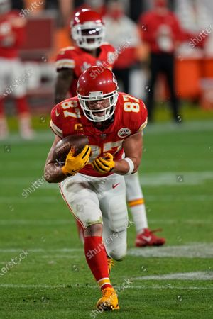 Kansas City Chiefs tight end Travis Kelce runs with the ball against the Tampa Bay Buccaneers during the second half of the NFL Super Bowl 55 football game, in Tampa, Fla