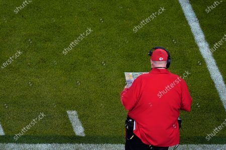 Kansas City Chiefs head coach Andy Reid looks at a play chart during the second half of the NFL Super Bowl 55 football game against the Tampa Bay Buccaneers, in Tampa, Fla