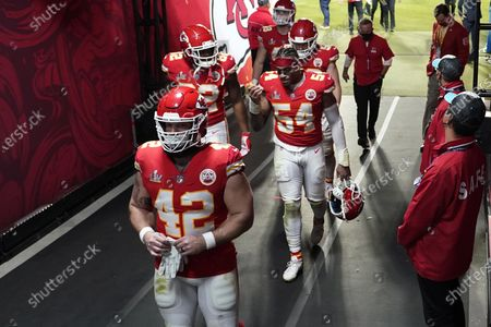 Kansas City Chiefs' Tyrann Mathieu (32) and teammates walk to the locker room following NFL Super Bowl 55 football game against the Tampa Bay Buccaneers, in Tampa, Fla. The Buccaneers defeated the Chiefs 31-9 to win the Super Bowl