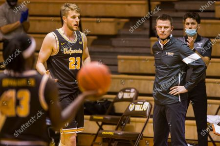 Valparaiso head coach Matt Lottich, front right, looks on as players Sheldon Edwards (13) and Ben Krikke (23) come off the court for a timeout during the second half of an NCAA college basketball game against Drake, in Valparaiso, Ind