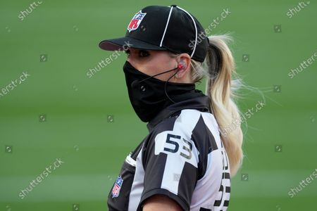 Down judge Sarah Thomas (53) watches on the field before the NFL Super Bowl 55 football game between the Kansas City Chiefs and Tampa Bay Buccaneers, in Tampa, Fla