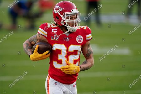 Kansas City Chiefs Tyrann Mathieu (32) warms up before the NFL Super Bowl 55 football game between the Kansas City Chiefs and Tampa Bay Buccaneers, in Tampa, Fla