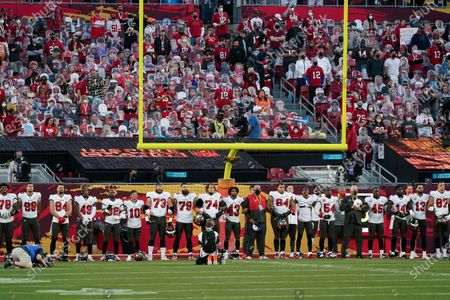 """Tampa Bay Buccaneers listen during Alicia Keys performs """"Lift Every Voice and Sing"""" before the NFL Super Bowl 55 football game between the Kansas City Chiefs and Tampa Bay Buccaneers, in Tampa, Fla"""