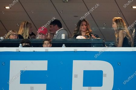 Gisele Bundchen, second from right, watches before the NFL Super Bowl 55 football game between the Tampa Bay Buccaneers and the Kansas City Chiefs, in Tampa, Fla