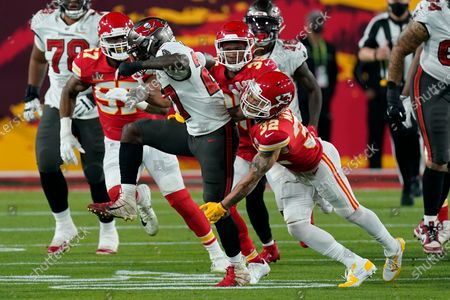 Kansas City Chiefs strong safety Tyrann Mathieu tackles Tampa Bay Buccaneers running back Ronald Jones during the first half of the NFL Super Bowl 55 football game, in Tampa, Fla