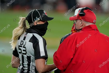 Kansas City Chiefs head coach Andy Reid, right, talks with down judge Sarah Thomas (53) during the first half of the NFL Super Bowl 55 football game against the Tampa Bay Buccaneers, in Tampa, Fla