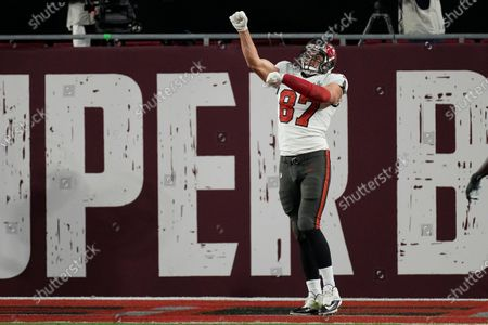 Tampa Bay Buccaneers tight end Rob Gronkowski celebrates after Antonio Brown scored a touchdown against the Kansas City Chiefs during the first half of the NFL Super Bowl 55 football game, in Tampa, Fla