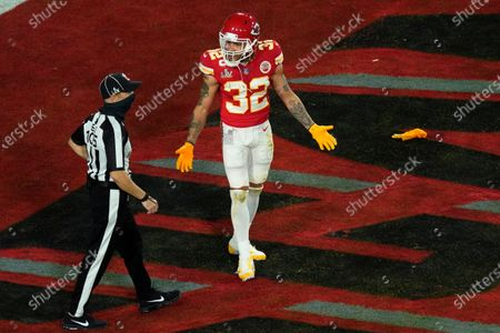Kansas City Chiefs' Tyrann Mathieu (32) talks with back judge Dino Paganelli (105) during the first half of the NFL Super Bowl 55 football game against the Tampa Bay Buccaneers, in Tampa, Fla