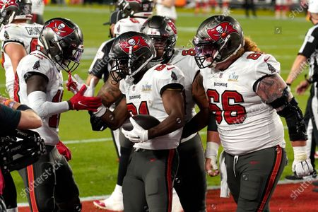 Stock Picture of Tampa Bay Buccaneers wide receiver Antonio Brown, center, celebrates with Ryan Jensen (66) and other teammates after catching a 1-yard touchdown pass during the first half of the NFL Super Bowl 55 football game against the Kansas City Chiefs, in Tampa, Fla