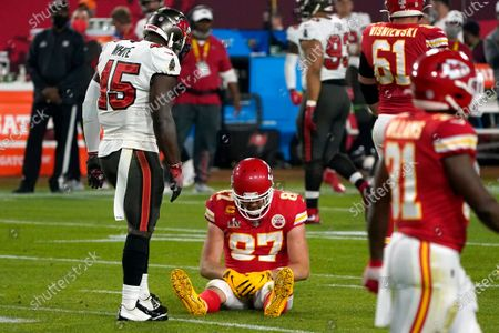 Kansas City Chiefs tight end Travis Kelce (87) sits on the field after an incomplete pass as Tampa Bay Buccaneers inside linebacker Devin White (45) looks on in the second half of the NFL Super Bowl 55 football game, in Tampa, Fla