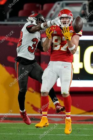 Tampa Bay Buccaneers free safety Jordan Whitehead breaks up a pass intended for Kansas City Chiefs tight end Travis Kelce during the second half of the NFL Super Bowl 55 football game, in Tampa, Fla