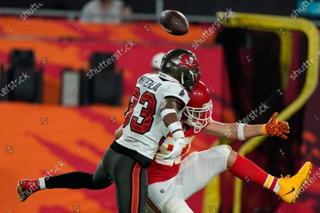 Tampa Bay Buccaneers free safety Jordan Whitehead, left, breaks up a pass intended for Kansas City Chiefs tight end Travis Kelce during the second half of the NFL Super Bowl 55 football game, in Tampa, Fla