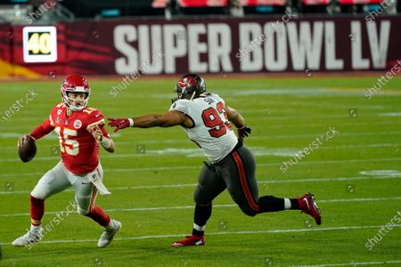 Tampa Bay Buccaneers defensive end Ndamukong Suh tries to tackle Kansas City Chiefs quarterback Patrick Mahomes during the second half of the NFL Super Bowl 55 football game, in Tampa, Fla